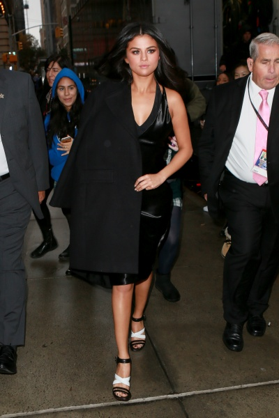 Selena Gomez black dress coat black and white sandals