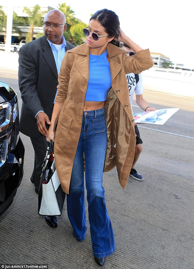 Selena Gomez blue top jeans beige suede jacket LAX photo jul-khh x17online com