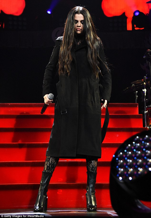 Selena black coat Staples Center Jingle Ball photo Getty Images for iHeartMedia