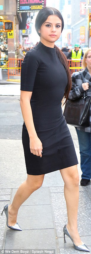 Selena Gomez black dress silver shies Times Square NY photo We Dem boys splash News