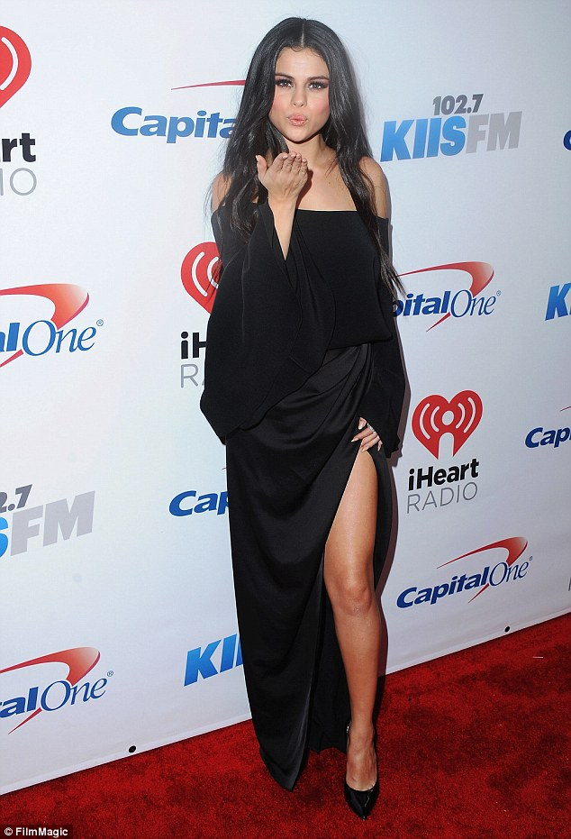 Selena Gomez black off the shoulder dress Jingle Bsal Staples Center photo FilmMagic
