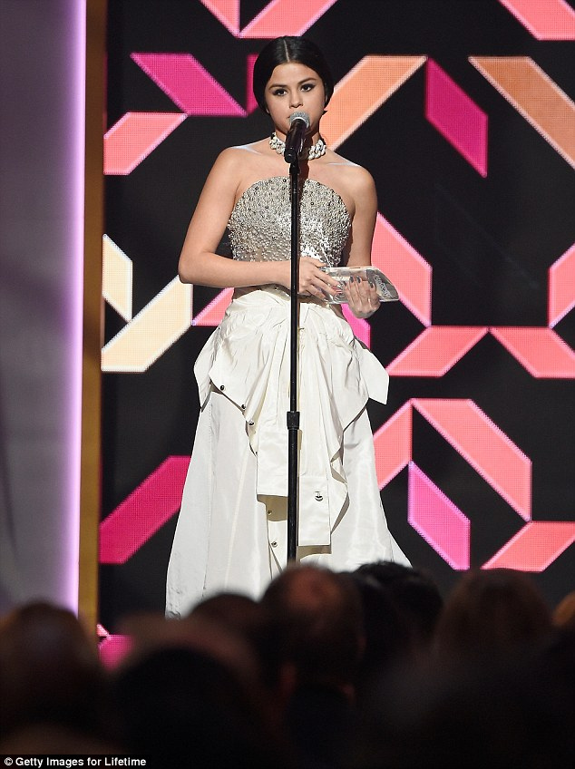 Selena gomez silver and white gown billboard Women in Music chart-topper Honour photo Getty imsges for Lifetime