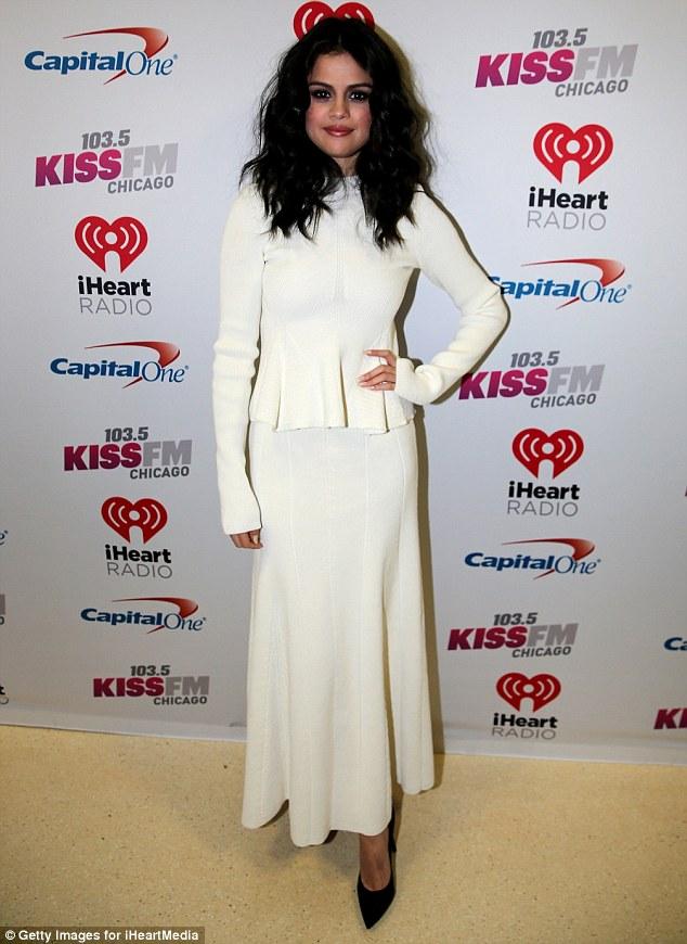 Selena Gomez white dress chicago Jingle Ball photo Getty images for iHeartMedia
