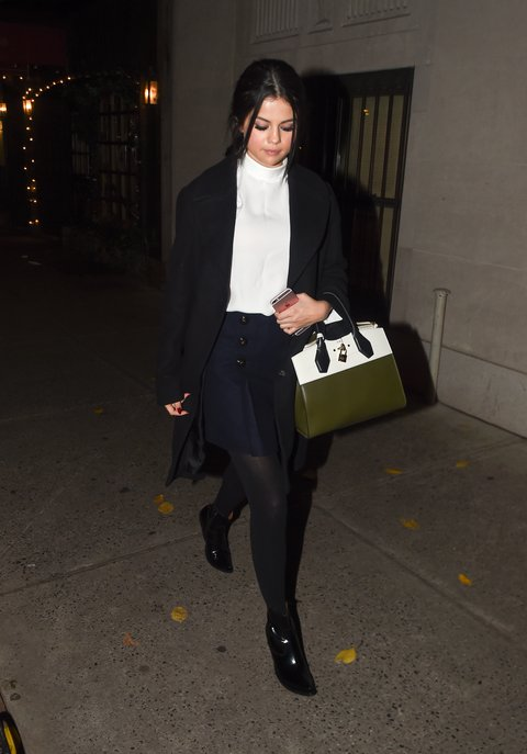 selena-gomez-white turtleneck black coat navy pleated skirt NY photo Big Media boss Splash News