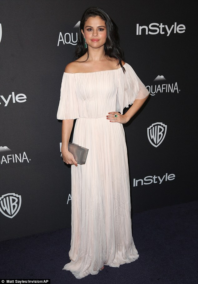 Selena Gomez white off the shoulder dress Golden Globes 2016 photo Matt Sayles Invision AP