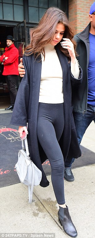 Selena Gomez black coat and leggings white turtleneck NY photo 247Paps TV Splash news