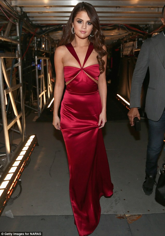 Selena Gomez red satin gown Grammy 2016 photo Getty Images for NARAS