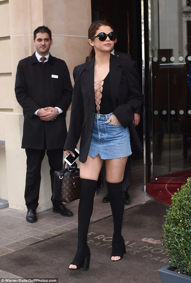 Selena Gomez black lace up top denim skirt black toless heels Paris 2016 photo Warner Eade GoffPhotos com