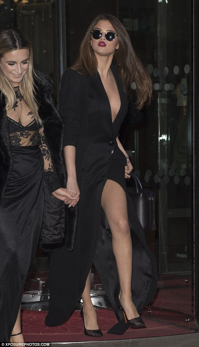 Selena Gomez black low cut split coat dress mesh shoes Paris 2016 photo Xposurephotos com