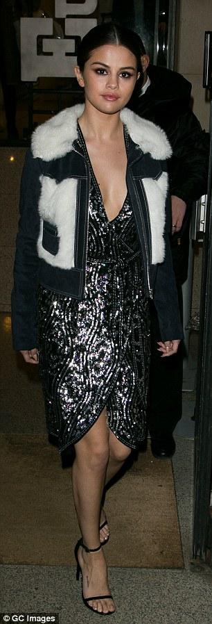 Selena Gomez black sequin dress denim and fur jacket black sandals Paris 2016 photo GC Images