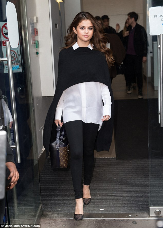 Selena Gomez black throw white shirt black trousers London 2016 photo MArio Mitsis WENN com