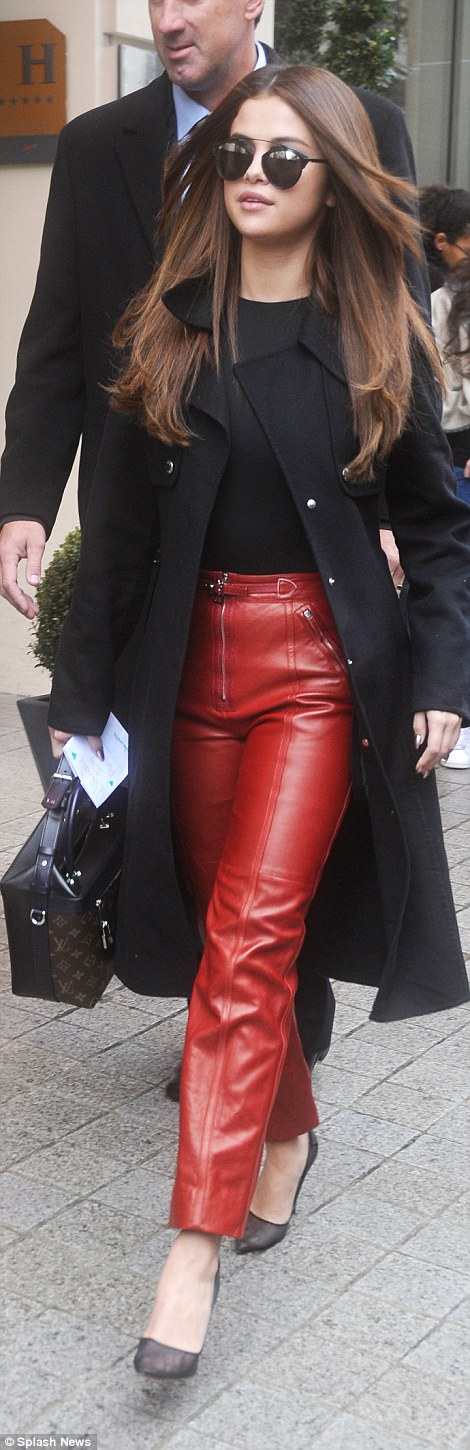 Selena Gomez black top black coat red leather pants black pumps Paris 2016 photo Splash News