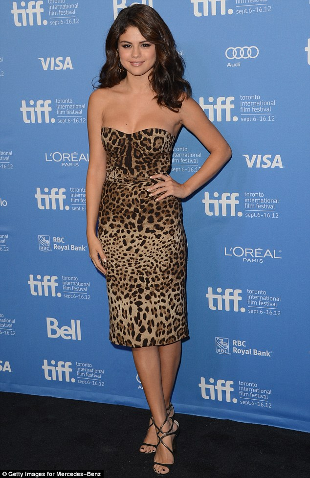 Selena Gomez leopard print dress 2013 photo Getty Images for Merceded Benz