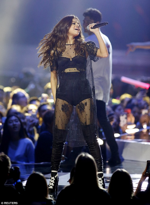 Selena Gomez black pants and bra lace dress black and white over the knee boots WE Day 2016 photo Reuters