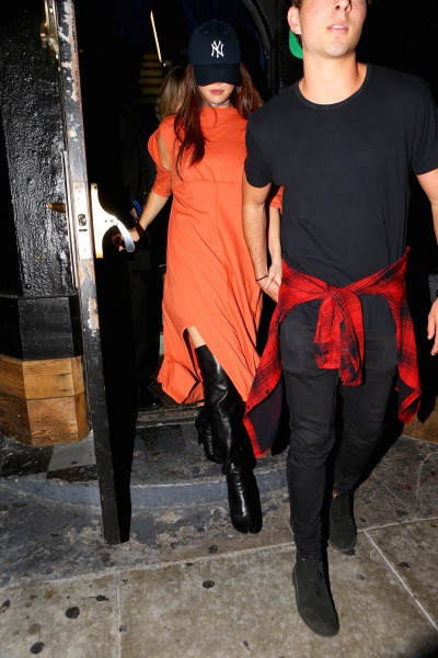 Selena Gomez orange dress black over the knee boots The Roxy MArch 2016