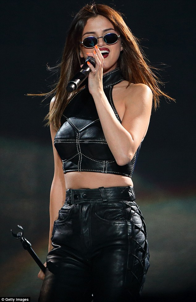 Selena Gomez black leather bralet and trousers Revival Tour Singapore photo Getty Images