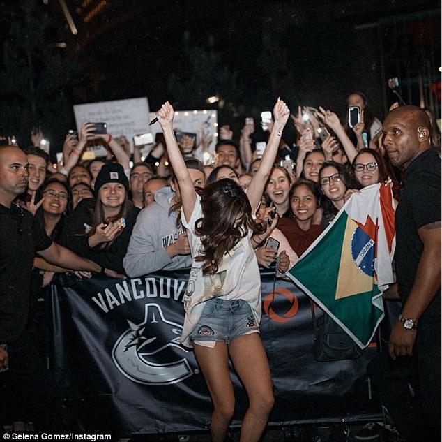 Selena Gomez denim shorts Bon Jovi t-shirt Vancouver