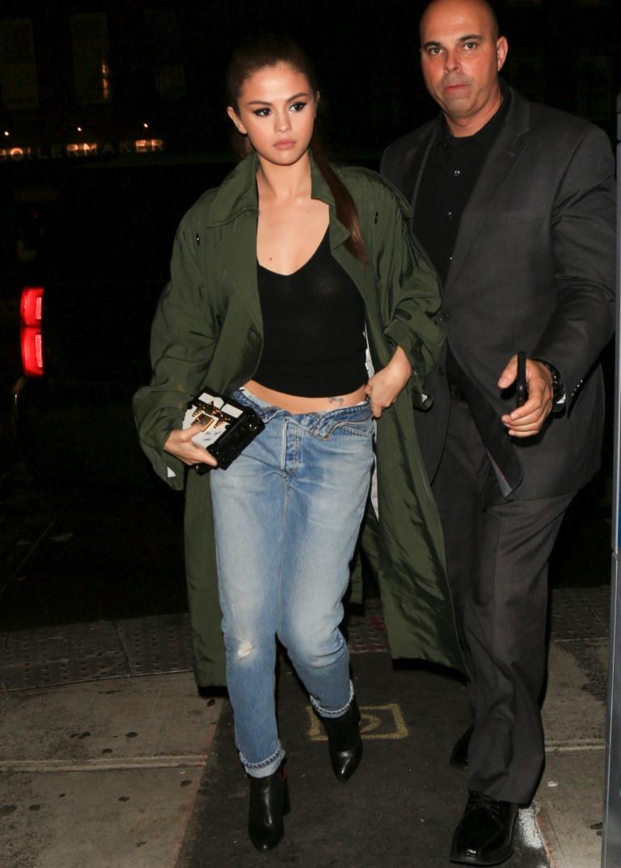 Selena Gomez green trench black boots Met Gala 2016