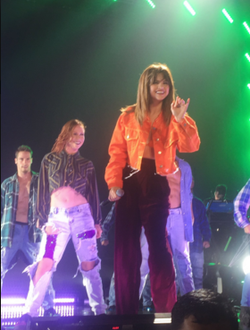 Selena gomez orange jacket and bra maroon trousers Revival tour photo mintzebra