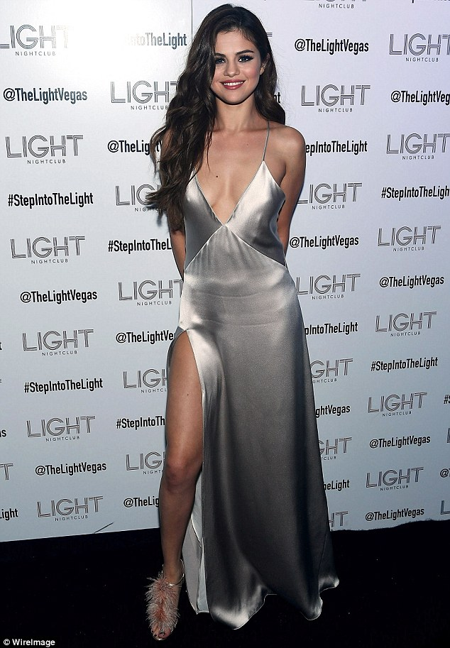 Selena Gomez silver dress The Light Nightclub photo WireImage