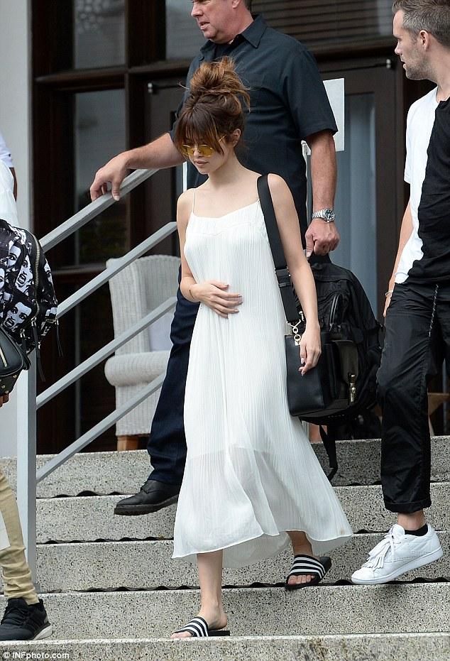 Selena Gomez white pleated dress Miami Revival tour phto INFphotos com