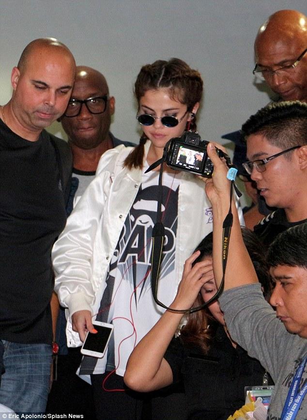 Selena gomez BAPe t-shirt white bomber Philippines photo Eric apolonio splash news