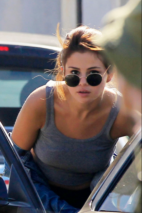 Selena Gomez grey crop tank 901 July 2016