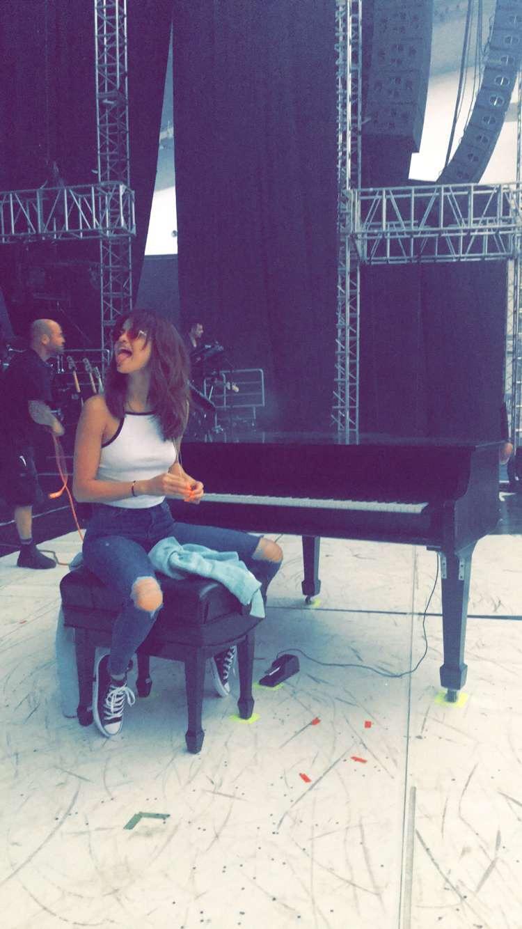Selena gomez white contrast trim top ripped jeans converse photo Snapchat