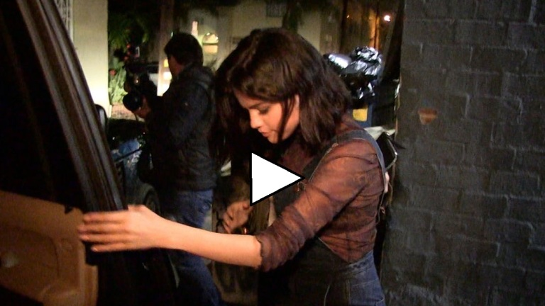 selena-gomez-denim-dungarees-video-photo-tmz
