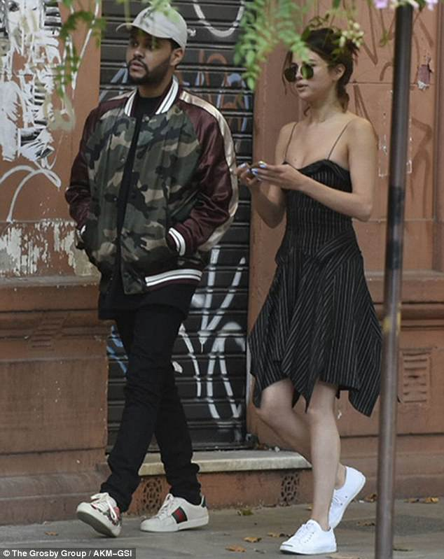 Selena Gomez black striped strappy dress Argentia with The Weeknd photo The Grosby Group AKM-GSI