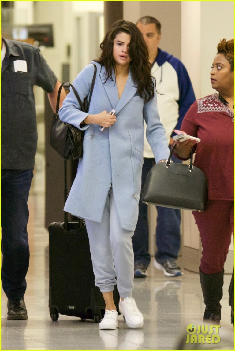 selena-gomez-lands-atlanta-pale-blue-asymmetric-coat-white-trainers