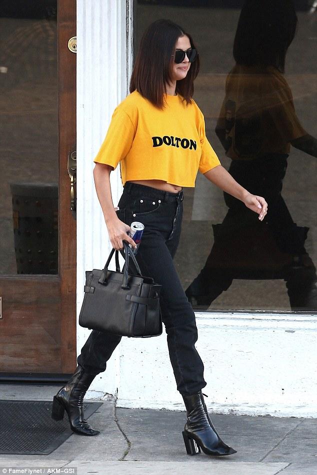Selena Gomez yellow Dolton cropped top black jeans photo FameflyNet AKM-GSI