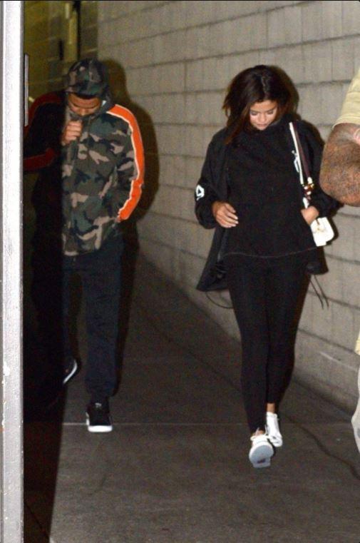 Selena Gomez black jacket white sneakers trainers white bag 16 June 2017