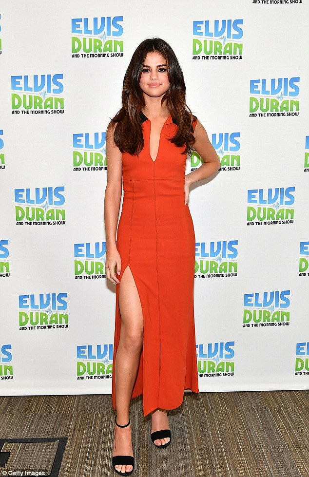 Selena Gomez orange MAxi Dress Elvis and Duran radio show NY 5 June 2017 photo Getty Images