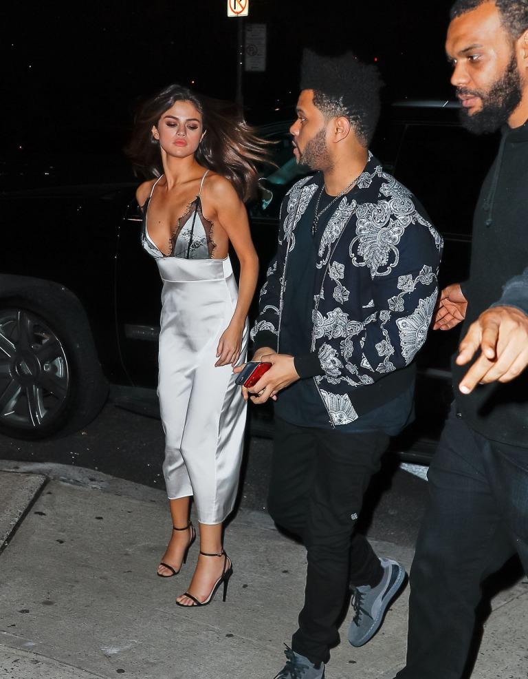 Selena Gomez silver slip dress black strappy sandasl Raos NY 5 June 2017