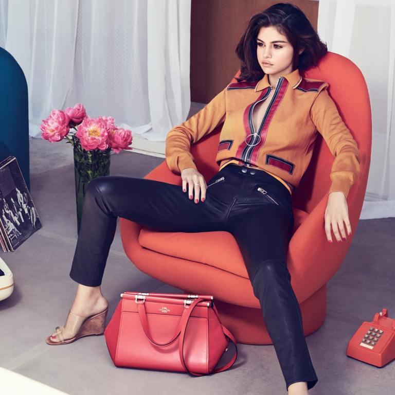 Selena Gomez brown zip top blue jeans red bag InStyle September 2017