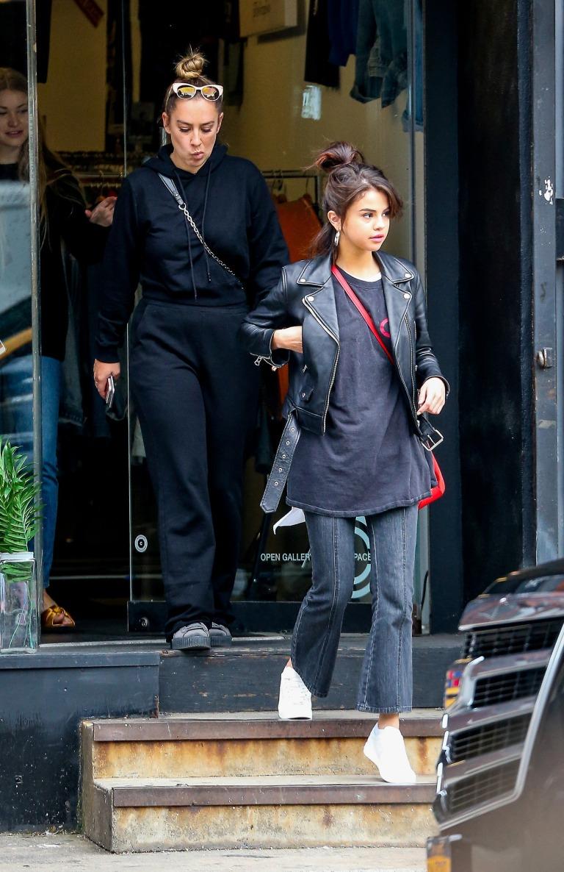 Selena Gomez black leather biker jacket jeans white sneakers trainers red bag New York September 2017 Selena Goemz street style