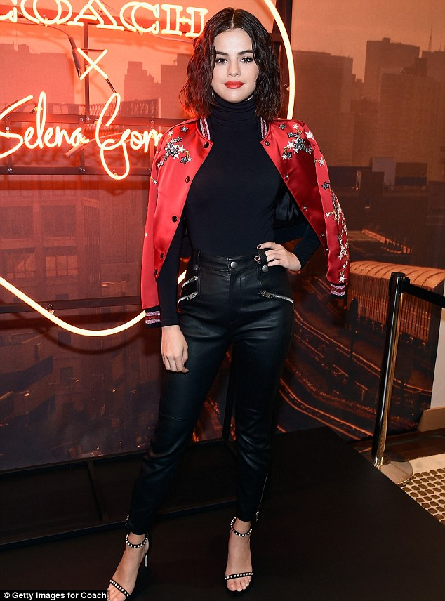Selena Gomez black leather trousers red satin star bomber jacket pearl sandals silver hoop earring Coach New York event September 2017 photo Getty Images Selena Gomez street style