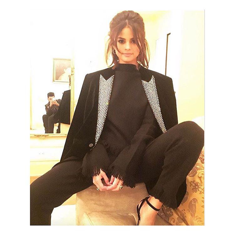 Selena Gomez black top and trousers with tuxedo jacket photo theweeknd Selena Gomez style September 2017