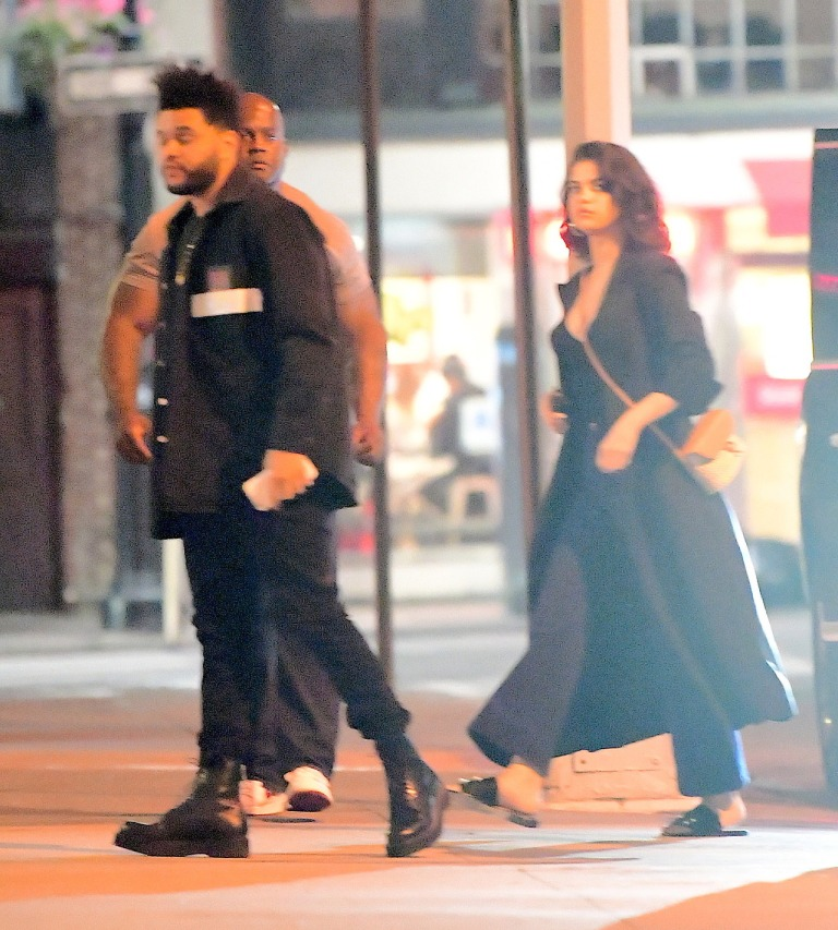 Selena Gomez style black outfit white bag with The Weeknd New York September 2017