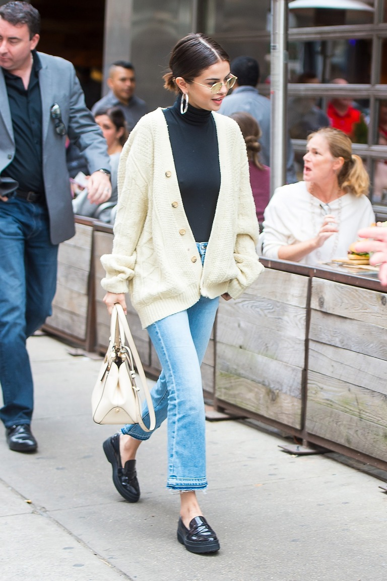Selena Gomez cream cable cardigan jeans black loafers white bag 29 September 2017 New york