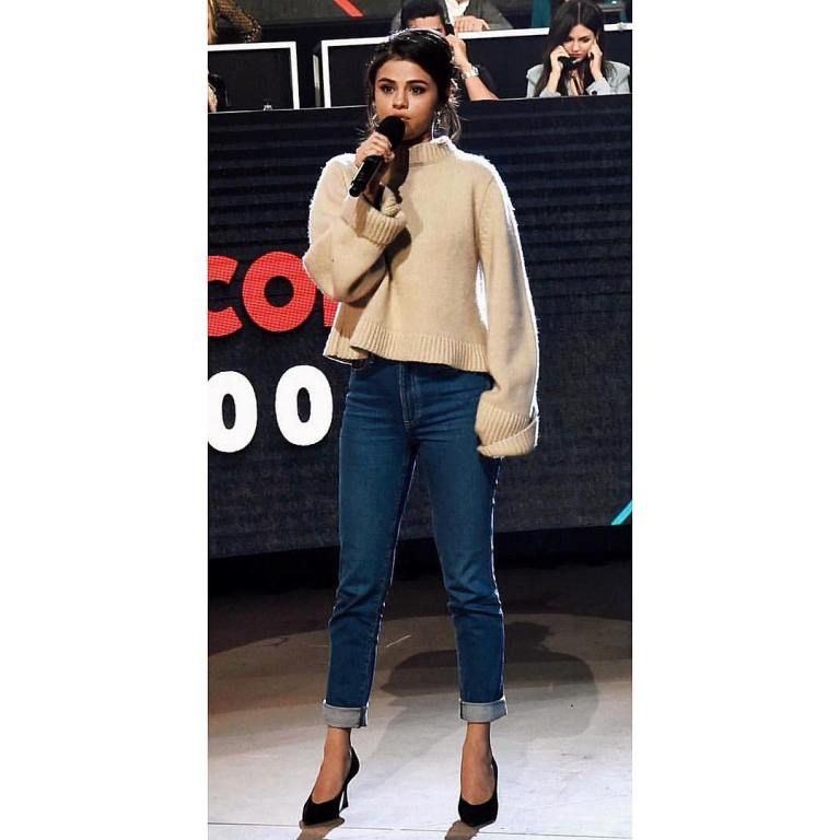 Selena Gomez cream sweater blue jeans black heels SOMOS phot Chris Classen