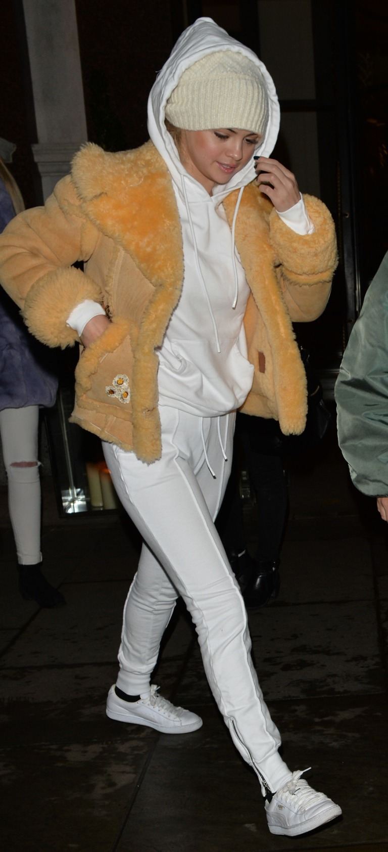 Selena Gomez white trainers shearling jacket London Hyde Park