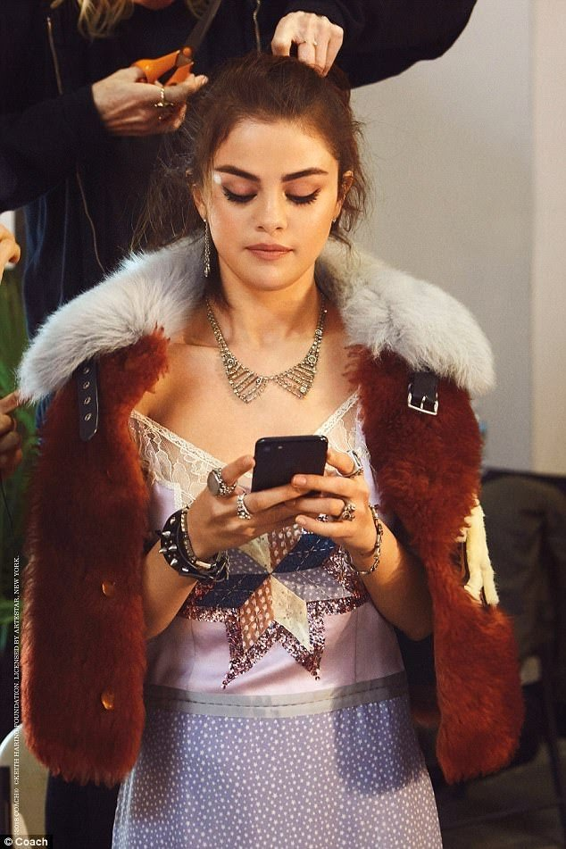 Selena Gomez style lilac dress tan fur jacket Coach SS18