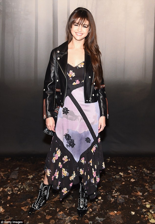 Selena Gomez style clothes fashion pink and black floral maxi dress black biker jacket pink and black padded bag February 2018