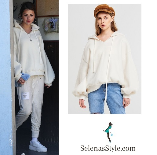 Selena Gomez style clothes outfit blog white hoodie pink pants white trainers Iceland skating centre March 26 2018