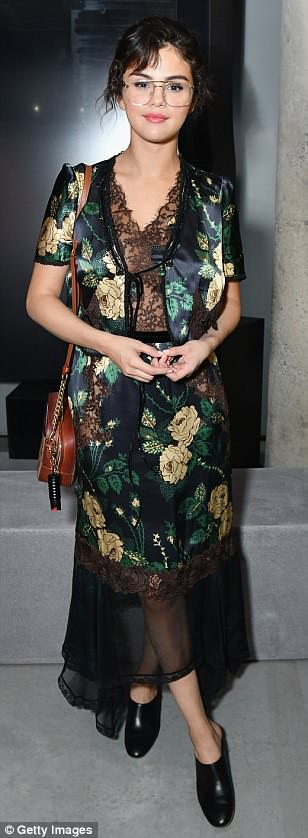 Selena gomez style black floral satin and lace dress black mules Prada Resort collection NY May 2018