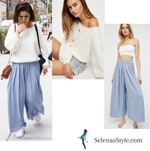 Selena Gomez style white top blue wide leg trousers white trainers brown bag NY May 2018