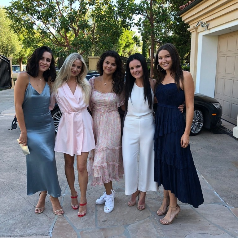 Selena gomez style clothes outfit blog pink frill dress white sneakers 22 July 2018