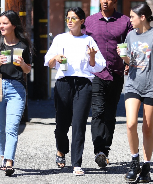 Selena gomez style blog white sweatshirt black jogging pants black and white slides September 2018
